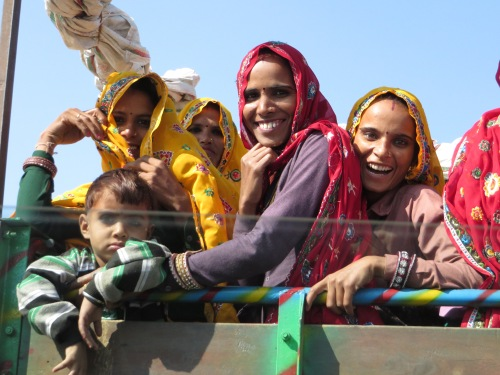 Agra to Jaipur, Women laughing on the back of a truck